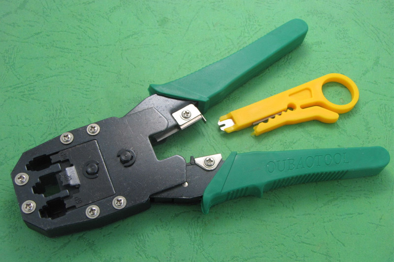 NETWORK CRIMPER AND WIRE STRIPPING TOOL